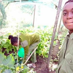 Women rangers working on their small garden